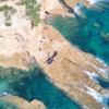 Helicopter-on-remote-rock-near-Kawau-Island