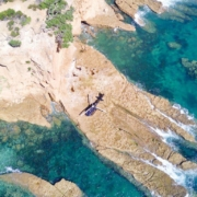 Helicopter-on-remote-rock-near-Kawau-Island