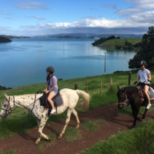 Two young riders at Te Matuku Bay