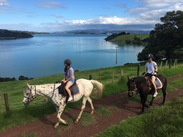 Two young riders at Te Matuku Bay