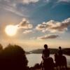 Young girls on horseback at sunset
