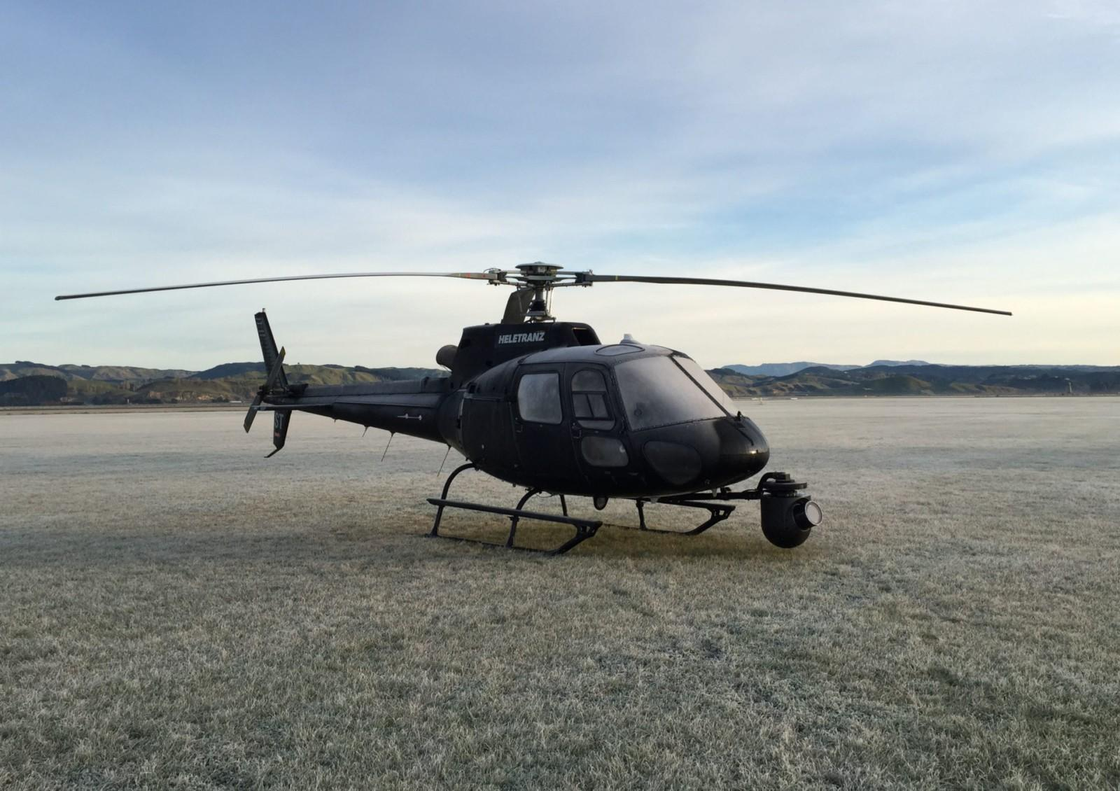 helicopter landed in frosty fieled with gyroscopic camera mounted on nose
